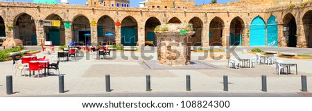 Ancient market square of  Middle Eastern Arab city and its modern reality - stock photo
