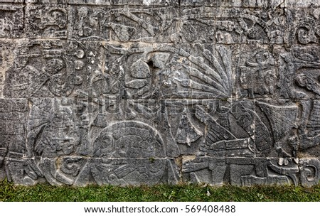 Ancient Mayan mural at the Great Ball Court in Chichen Itza depicting headless body of a player with the snakes streaming out of the neck. The ball game was symbolic of death and rebirth. #569408488