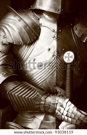 Ancient metal armor in sepia. - stock photo