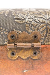 Ancient metal hinges on a wooden suitcase.