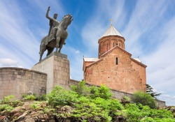 Ancient Metekhi church and Vakhtang Gorgasali monument in Tbilisi, Georgia