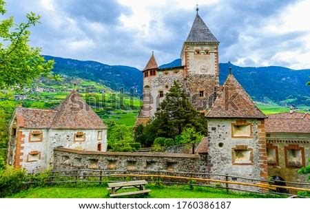 Ancient monastery in mountain landscape. Monastery in mountains. Mountain village ancient monastery