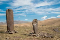 Ancient monuments idols in Armenia. Pagan idols and beautiful mountain landscape.