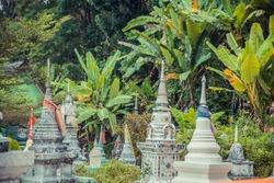 Ancient mystical thai cemetery near old temple. Thailand.