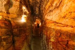 Ancient narrow underground passage in sandstone at old underground monastery