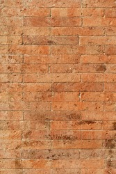 Ancient orange brick wall during a sunny day