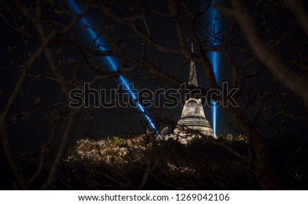 Ancient pagoda on the mountain of Thai people for praying and traditional celebrate festival with light and fireworks on night time. #1269042106