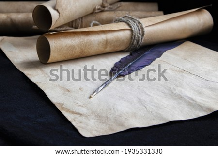 Ancient paper scrolls sealed with a seal on an old map. Pen for writing.