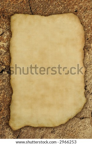 Ancient parchment fragment on rock background