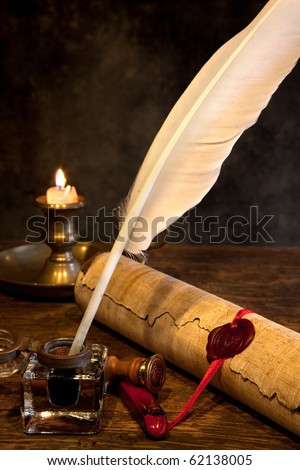 Ancient parchment or diploma scroll with wax seal and quill pen