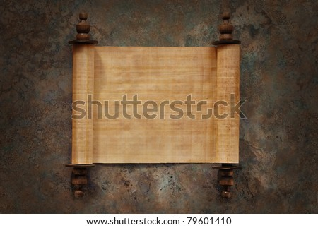 Ancient parchment scrolls with blank papyrus opened on a stone background with clipping path