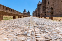 Ancient paved stone road in the medieval castle of Carcassonne town
