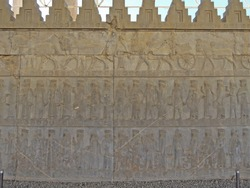 Ancient Persian bas-relief from Apadana palace in Persepolis, depicting Persian & Midian nobles & royal courtiers. Upper line of relief showing their servants & chariots. Persepolis, near Shiraz, Iran