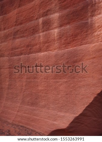 Ancient petroglyphs carved in red rock, Navajo Prehistoric Art Cave Painting in Buckskin Gulch canyon, Arizona