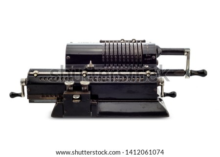Ancient pinwheel mechanical calculator.The calculating machine, is a mechanical device used to perform automatically the basic operations of arithmetic, rendered obsolete by electronics calculators. #1412061074