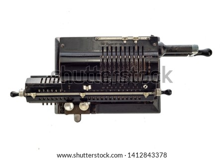 Ancient pinwheel mechanical calculator.The calculating machine, is a mechanical device used to perform automatically the basic operations of arithmetic, rendered obsolete by electronics calculators. #1412843378