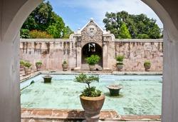 Ancient pool at Taman Sari water castle - the Royal garden of sultanate of Yogyakatra.  Java, Indonesia.