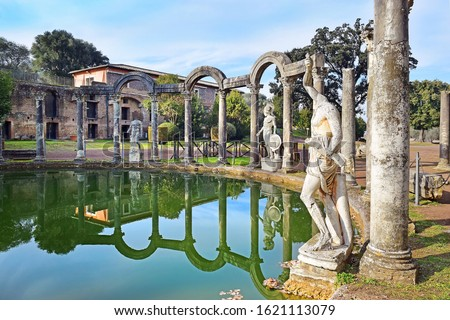 ancient pool called Canopus, surrounded by greek sculptures in Villa Adriana (Hadrian's Villa) and reflections in water in Tivoli, Italy Stock fotó ©