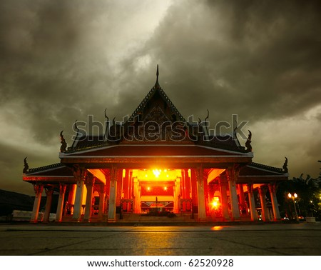 Ancient praying building at night with dark clouds