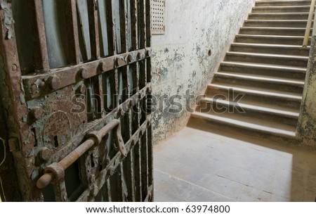 Ancient prison door opening onto the steps, and way out.