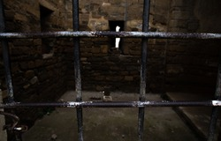 Ancient prison in the fortress with windows