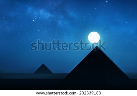 Stock Photo Ancient pyramids at night - night sky filled with stars