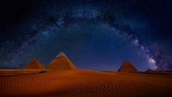 Ancient Pyramids of Giza at night against the stars and Milky Way Galaxy, Egypt. Astrophotography, fantastic background, beautiful dunes in desert, panoramic view