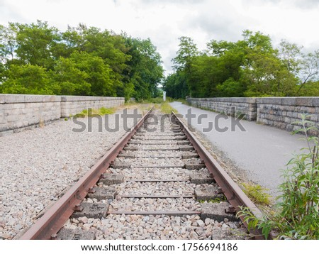 Ancient railroad line in Norman Switzerland (Clécy, Normandy, France). Located on a beautiful viaduct. Now it is the 'voie verte' for bikers and pedestrians.  Photo stock ©