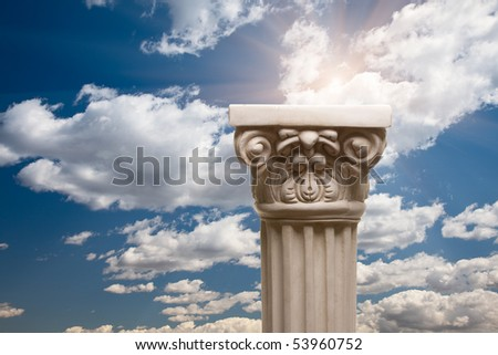 Ancient Replica Column Pillar Over Dramatic Clouds and Sunburst. - stock photo