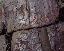 Ancient rock paintings petroglyphs in the Altai Mountains, Russia.
