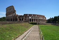 Ancient Roman amphitheater and gladiator arena Colosseum, heart of Roman Empire, famous tourist landmark, guided tour concept, Rome, Italy