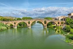 Ancient roman bridge across the Arga river in Puente la Reina, near Pamplona, Navarra, Spain