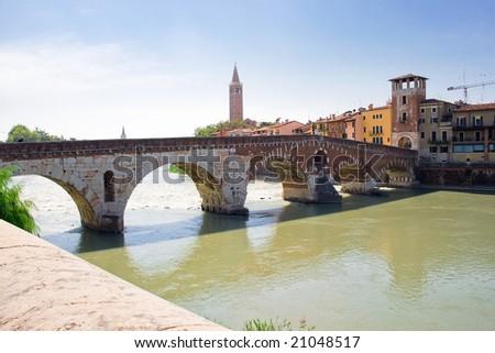 Ancient roman bridge over Adige river in Verona, Italy