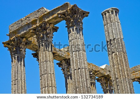 Ancient Roman building columns: detail of columns of ancient Roman building (Temple of Diana) in ruins in Evora, Portugal, with Corinthian style capitals.