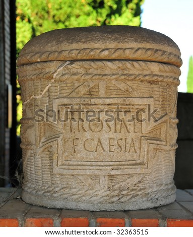 ancient roman burial urn including lid and jar for the ashes and bearing inscription for the decesased