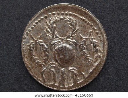Ancient Roman coin on a black background #43150663