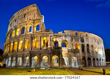 Ancient roman colosseum at dusk, Rome, Italy