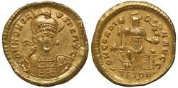 Ancient Roman Empire golden coin solidus 408-423 AD, armored and helmeted bust of Emperor Honorius 3/4 right, Concordia on throne as personification of Constantinople holding Victoria,