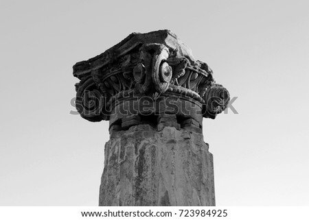 Ancient roman greek column with broken chapiter. Pompeii, Italy. Black and white photo #723984925