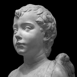 Ancient roman marble portrait of a boy. Young man head statue isolated on black background. Antique sculpture