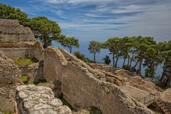 Ancient roman ruins of Villa Jovis. The ruins of Villa Jovis built by emperor Tiberius is located at the edge of a tall cliff on the island of Capri, Tyrrhenian sea, Italy