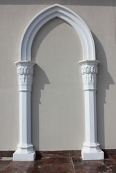 Ancient Roman-style archway with wall background.