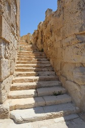 Ancient Roman style outdoors stairway made of limestone going upwards towards the sky
