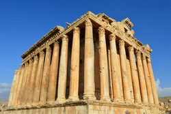 Ancient roman temple of Bacchus in the City of Baalbek, Lebanon. Impressive view from the corner with clear blue sky in the background.