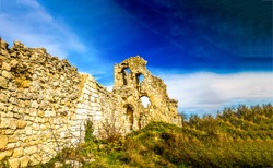 Ancient ruin of stone fortress wall. Ruined wall in ruin city