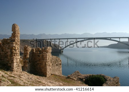 Ancient ruins and bridge over the sea