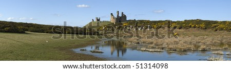 Ancient ruins of Dunstanburgh Castle, Northumberland