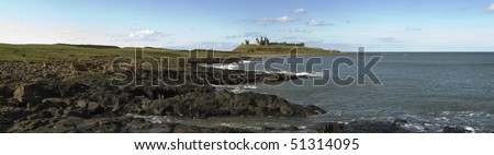 Ancient ruins of Dunstanburgh Castle overlooking the North Sea