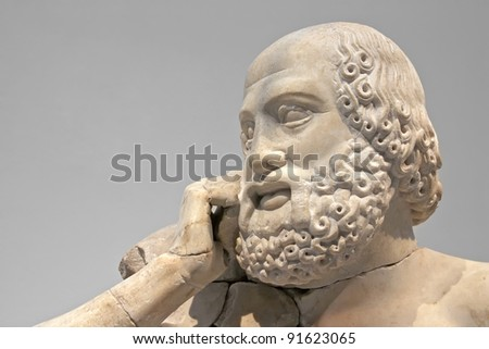 Ancient ruins of the Philippeion at Olympia, Greece. Detail of an ancient Greek statue of a human. Site of the ancient Olympic Games is situated on the Peloponnese. UNESCO world heritage site.