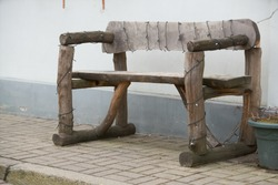 Ancient rural bench from logs. Isolated over white. Roughly hammered together wooden bench.